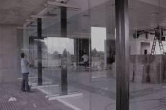 Frente flexible con vidrios